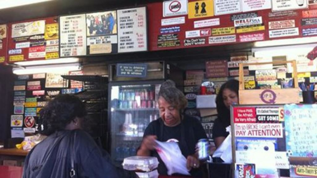 Lady paying for food on counter